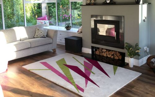 Hand tufted cream rug with colourful shapes