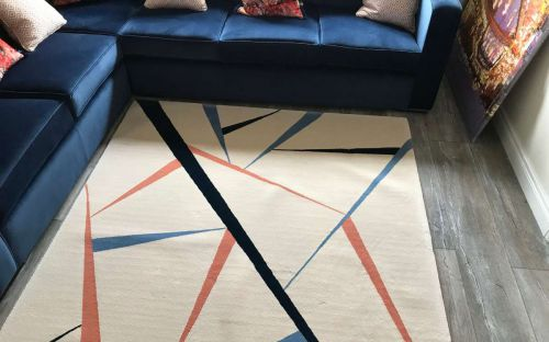 Hand tufted cream rug with colourful chards design